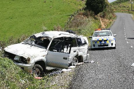 Two women were lucky to escape with only minor injuries after their car rolled multiple times. Photo / Mark McKeown