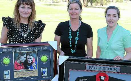 Emily Hetherington (BUSHkids), Astrid Turner (Pro Shop) and Rebecca Wright (BUSHkids) with some of the items up for auction at this year's charity golf event.