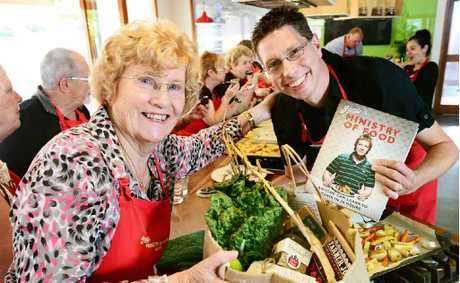 CUISINE CAPERS: Kate Vermeer Bowers, 82, of Tivoli, is the 1000th participant to finish Jamie's Ministry of Food course in Ipswich. She celebrated yesterday with Ministry of Food centre manager Darren Foxcroft.