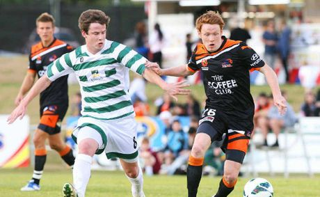 HIGHER HONOURS: Western Spirit's best player Dan Liddy (left) represents Ipswich during the recent invitational match against Brisbane Roar.