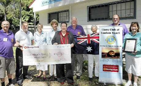 EVENT FUNDING: Coolum Lions Doug Alford, Coolum Business and Tourism president Noel Mooney, Quotarians Jan Crossland and Lorraine Raison, Bendigo Bank's Judy Blackall, Coolum Lions Don Knopke and Phil Peterson and Lionesses Shirley Salisbury and Robyn Peterson celebrate the $5000 funding announcement by Bendigo Bank for next year's Australia Day Spectacular in Coolum.