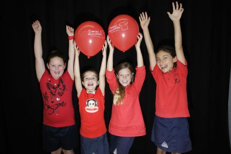 Year 3 students Baylee Lynch, April Braiden, Emilee Baker and Putri Clark from Bribie Island State School wear red for Daniel Morcombe awareness day at the school on Tuesday. Photo Vicki Wood / Caboolture News