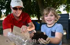 Worm farm at Twin towns community kindy. Ned Tanner and Simon Schubert of South Tweed Heads Bunnings. Photo: John Gass / Daily News