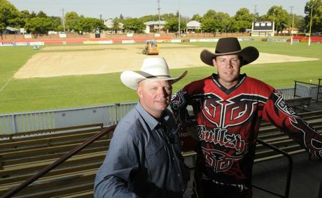 Professional Bull Riders Australia general manager Glen Young (left) and Dan Roberts check out the temporary conversion of Clive Berghofer Stadium to a bull riding venue.