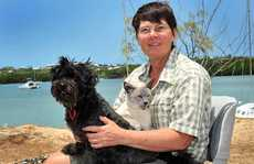 SALTY DOG AND FELINE: Kathleen Lindenberg with pets Eddie and Kimba who love nothing better than a day out on the water.
