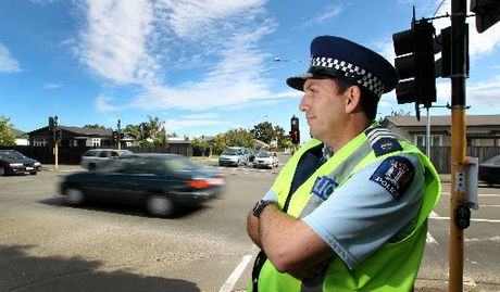 Sergeant Clint Adamson of Hawke&#39;s Bay Police doing what he and his colleagues will be doing a lot of this long weekend - keeping an eye on drivers.