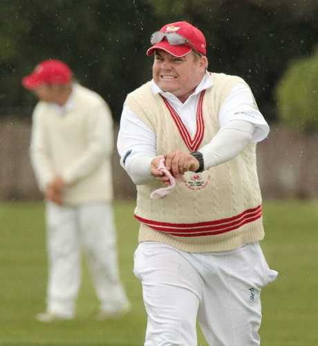 BRRRRR! Tech skipper George Diack shines the ball in the rain as a team-mate shivers in the background.