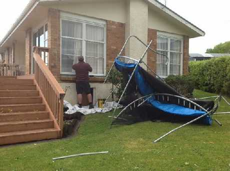 Strong winds caused a trampoline to take flight and smash windows in a Greerton home.