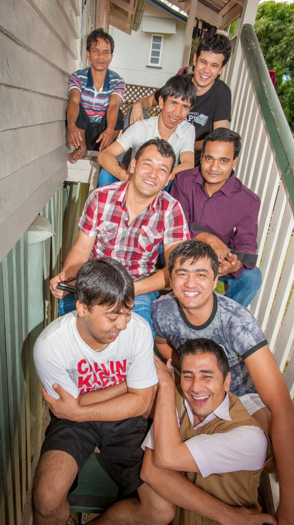 AT HOME: (Bottom from left) Mohammad Azad, Haider Ali Ahmadi, Idres Mohammadi, Ali Abbas Rezai, Abdul Hamid, Moshen Fadaee, Abbras Ali Rezai and Mohammad Azub settle into life in Rockhampton together after fleeing their conflicted countries of birth.