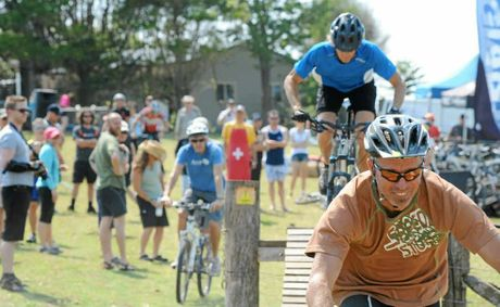 RIDE 'EM: Bikes, bumps and bystanders at Byron Bay's mountain bike trail.