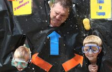 Damon Cox, teacher Shaun Tavernor and Jarod Baxter get wet and wild at the sponge toss at Centaur school's Carnivale.