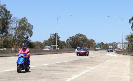 What the? A scooter rider is seen heading south along the Pacific Hwy just after Terranora Creek Bridge.