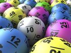 A BRISBANE father in his 30s has scooped the entire first division Powerball prize pool of $40 million overnight.