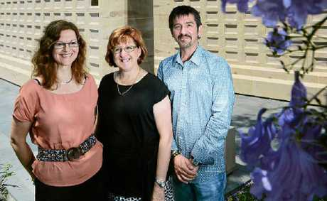 PROUD WINNERS: Ipswich architects Jacqui Pearce (left) and Ziggy Zivojinovic (right), with St Mary's Parish pastoral assistant Bernadette McAndrew, admire the sandstone columbarium which won gold in the 2012 Awards for Excellence.