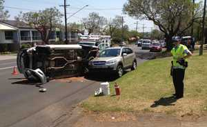 A ute was forced onto its side after a collision on Ruthven St.
