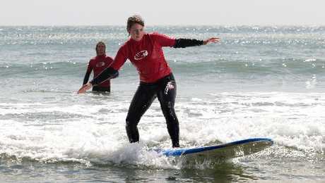 Stephanie Buehler, from Switzerland, tried her luck surfing at Main Mount Beach over Labour Weekend.