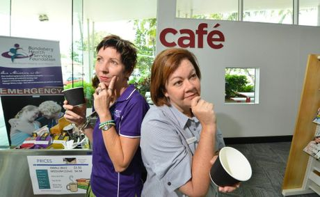 NEW NAME: Bundaberg Health Services Foundation manager Maria Burnet and Youth and communities librarian Sue Gammon ponder over a likely name for the coffee shop.