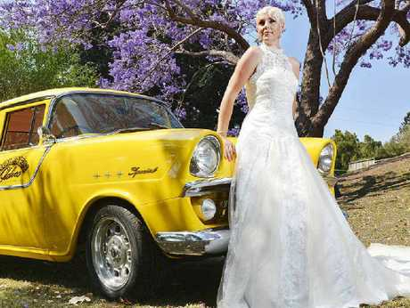 ELEGANT: Von's Gorgeous Gowns model Simone Tiplady poses with a Holden Oldies limo to promote the Bridal Expo.