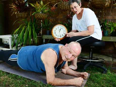 AMAZING FEAT: Doug Fenwick, 81, shows his record-breaking planking form to his wife Chris.