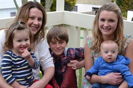 Pictured with mum Sarah are Arabella (on Sarah's lap), Callum and Brianna, holding Darcy.
