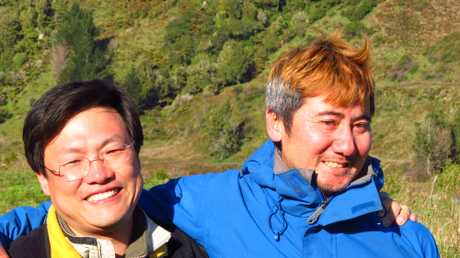 Siow &#39;Desmond&#39; Hong Kuik, right, hugs his hunting companion (name unavailable) who had been waiting for him. Kuik had been missing in the Ureweras for 4 days.