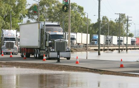 Trucks finally roll into Rockhampton from the South after the Bruce Highway was reopened after two weeks once flood waters receded. Photo Chris Ison / The Morning Bulletin ROK140111-truck-c2