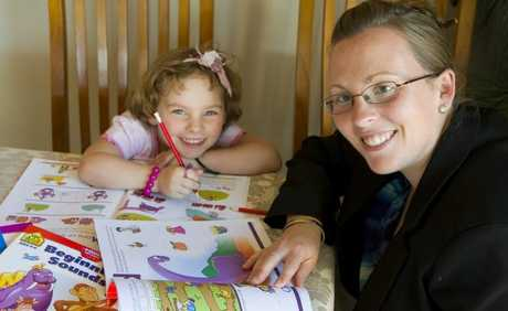 Jayme Salmon of Toowoomba Home Tutoring, with her daughter Claire, is seeing increasingly younger students come to her for extra tutition.