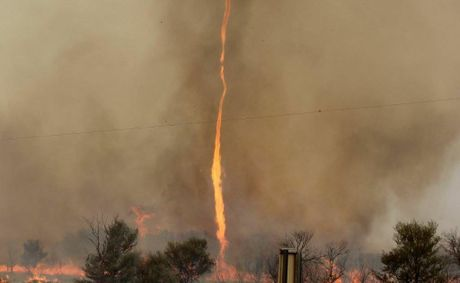 A fire tornado at Thargomindah taken by Belinda Easton. The rare destructive phenomenon occurs when an intensely hot fire sucks in cold air. The twister shot 300 metres in the air.