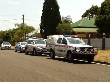Police vehicles outside a residence in Silkstone where a gunman allegedly threatened a woman.