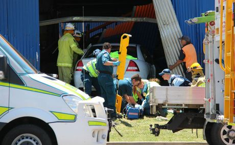 Paramedics work on male driver who crashed his car into the Beaurepaires workshop.