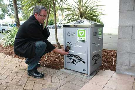 Grant Alsop, Whangarei District Council field officer, at one of the recycling bins where smartphone owners can earn points.