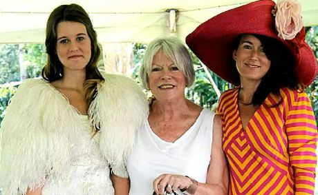 CLASSIC: Pam Le May with Emmie, right, in the Christian La Croix outfit, and Emmie's daughter Natasha wearing the 1930s bridal gown.