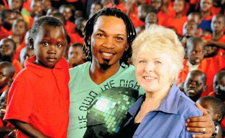 SONGS OF HOPE: George Lubega and Irene Gleeson with kids from the Irene Gleeson Foundation in northern Uganda.