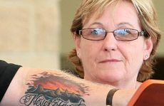 Denise Morcombe looks over Bruce Morcombe&#39;s tattoo. They will never forget Daniel.