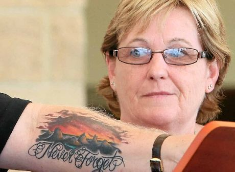 Denise Morcombe looks over Bruce Morcombe's tattoo. They will never forget Daniel.