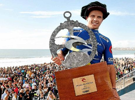 NAIL BITER: Julian Wilson claimed his maiden ASP World Tour victory after clinching the final of the 2012 RipCurl Pro Portugal. INSET: Wilson in action.