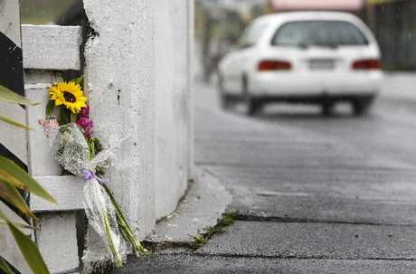 Flowers adorn the Whangarei bridge where Ashlee Edwards was found dead. Photo / Michael Cunningham