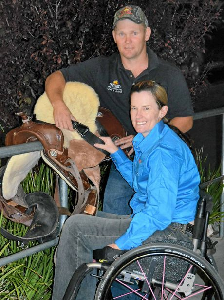 Kristy Banks and husband Dale Groves with her saddle and safety belt for her barrel racing debut this weekend.