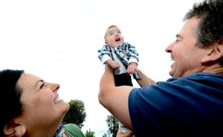 Mum and dad Laura and Tony Hurley with son Luca. Photo: John Gass / Daily News