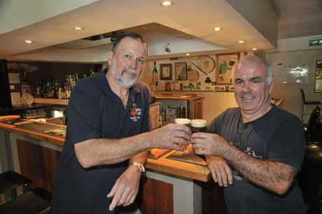 The old and new manager of Finbars Lounge and Bar in Maleny, John McCormack, right, Kerry Woods. Photo: Brett Wortman / Sunshine Coast Daily