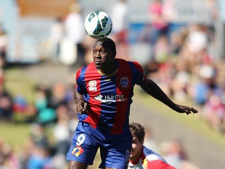 Emile Heskey of the Jets heads the ball away during the round one A-League match between the Newcastle Jets and Adelaide United at Hunter Stadium on October 7, 2012 in Newcastle, Australia.