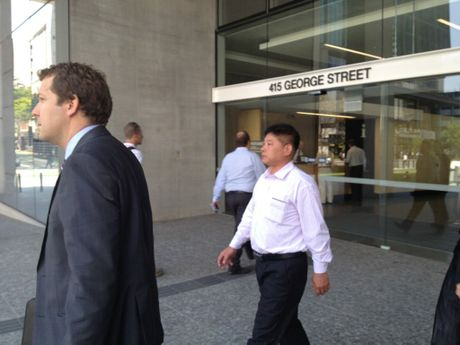 Chinese man Xuegang Wang, who was in charge of the ship Shen Neng 1 when it run around on the Great Barrier Reef off Central Queensland, at Brisbane District Court.