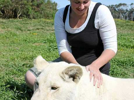 Libby shares a quiet moment with Skyla, the two-year-old white lion.