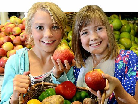 Sophie Mackney and Isabell Heaton grab a basketful of organic fruit and vegetables at The Natural Food Store.