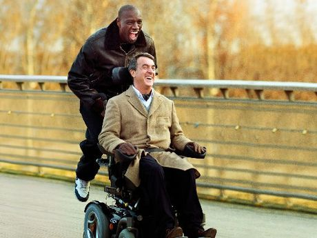 Francois Cluzet plays Philippe and Omar Sy plays Driss with Anne Le Ny (Yvonne) in the touching yet funny movie The Intouchables.