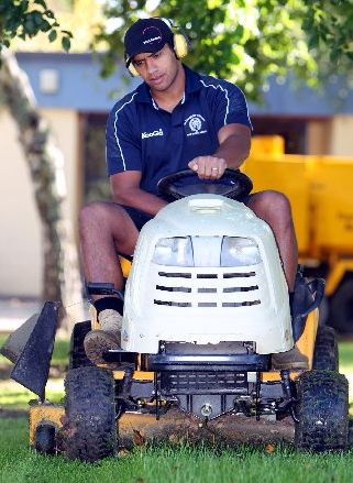 STAYING PUT: Everard Reid at work as a groundsman at Flaxmere College intends to stay in the Bay despite taking a liking to Tokomaru Bay.