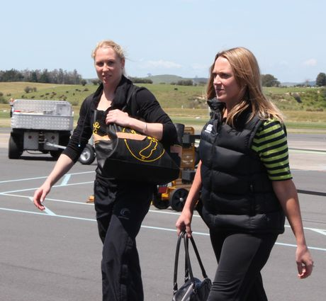 Silver Ferns Laura Langman (left) arriving at Tauranga airport.