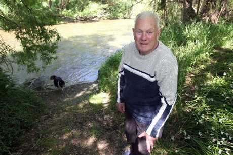 RIVER WATCH: Masterton riverside rubbish vigilante Gary Watt, with his shetland collie Pharoah in the background, will be back on his volunteer beat combing stretches of the Waipoua and Ruamahanga riverbanks for rubbish.