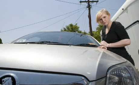 Cindy's Convenience Store worker Sherrin Mann shows the scratches caused by a powerline falling on her car.