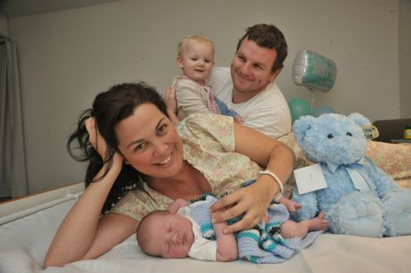 Sami Muirhead with her new baby boy Nixon, husband Sam Bohner and daughter, Avalon. Photo: Brett Wortman / Sunshine Coast Daily
